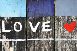 love your neighbor on a fence